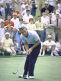 Golfer Arnold Palmer Lining Up Putt as Spectators Look on at Event