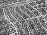 Aerial View of Acres of New Homes  Creating Compact Rows in Suburban Area Called Westchester