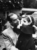 Director Vincente Minnelli Holding Daughter Liza in His Lap at an Outdoors Children's Party
