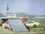 Daredevil Motorcyclist Evel Knievel Rising Very High Off Platform During Performance of a Stunt