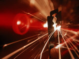 Red Laser Light Focused Through Lens Blasts Pin Point Hole Through Razor in Thousandth of a Second
