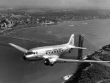 Canadian Colonial Airways Passenger Plane Flys over George Washington Bridge in Montreal  Canada