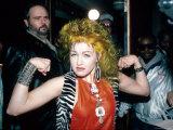 Singer Cyndi Lauper Flexing Her Muscles