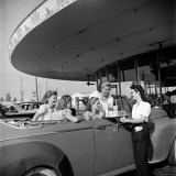 Women and Girls  in Convertible at Drive In  Greet Female Car Hop  Who Just Brought Their Drinks