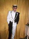 Singer and Songwriter Elton John in Black and White Tuxedo  Wearing Sunglasses