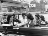 Teenage Girls Enjoying Milkshakes at Drive in Restaurant