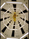 Distance Shot of Actor in Astronaut Suit Walking Through Geometrically Designed Hal Computer Center