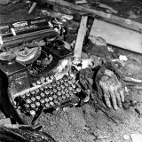 Grotesque Bomb Severed Hand next to German Typewriter in the Rubble of Air Raid by Allied Forces