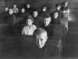 Russian Elementary School Students Sitting at Desks in Classroom in Remote Village in Volga Region