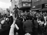 Sen Robert Kennedy Standing on Roof of Car as He is Swamped by a Crowd of Welcoming Well Wishers