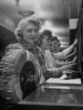 Line of Operators at Macy's Main Switchboard  with Alice Lennon Flipping Through a Rolodex File