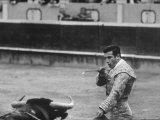 Spanish Matador  Antonio Ordonez Prepares to Kill the Charging Bull During Bullfight