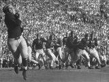 Michigan University's Bob Mann Catching a Pass From His QB Bob Chappuis