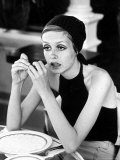 British Fashion Model Twiggy with Slumpy Posture  at Table in Restaurant at Disneyland
