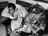 African American Baby Next to Cage of Canaries in a Shelter at School During Severe Flooding