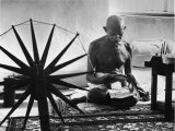 Indian Leader Mohandas Gandhi Reading as He Sits Cross Legged on Floor
