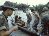 Nationalist S Vietnamese Soldiers Loading Viet Cong Prisoners Onto Canoe Like Boats in Mekong Delta