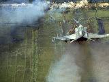 American F4C Phantom Jet Firing Rockets into Viet Cong Stronghold village During the Vietnam War