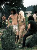 Hippie Couple Posed Together Arm in Arm with Others Around Them  During Woodstock Music/Art Fair