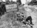 American Soldier Elmer Habbs of Delaware Resting as Troops Advance in Allied Invasion of Normandy