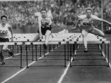 US Runner Fanny Blankers Koen Setting Olympic Record of 112 Seconds in 80 Meter Hurdles