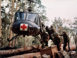 "American 4th Battalion  173rd Airborne Brigade Soldiers Loading Wounded Onto a ""Huey"" Helicopter"