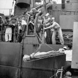 Wounded Australian Soldier Being Hoisted Aboard American Hospital Ship