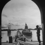 US Soldier Standing Guard over Section of Panama Canal  Battleship with Full Crew on Deck