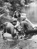 Actress Pier Angeli  Clad in Strapless Chiffon Party Dress Sitting on a Rock in a Pond