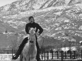 Actor Robert Redford Exercising One of His Eight Saddle Horses on His Remote Mountain Ranch