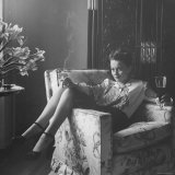 Actress Olivia de Havilland with Cigarette and Glass of Beer in While Relaxing at Home