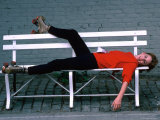 Actress Melissa Gilbert Reclining on a Bench While Wearing Roller Skates