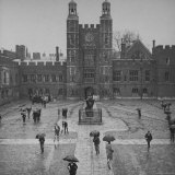Eton Students in Traditional Tails and Striped Trousers  with Umbrellas  Standing in the Rain