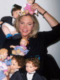 Actress Kathleen Turner Posing with Dolls as Promotion for Her Film &quot;Baby Geniuses&quot;