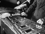 Hands of Percussionists Sam Borodkin Playing the Share Drum and Albert Rich Playing the Xylophone