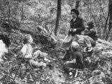 Biologist/Author Rachel Carson Holding Camera with Children and Dog in Woods Near Her Home