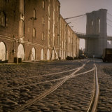 Shuttered Warehouses Lit by Sunlight on Trolley Track Railed Street Along Brooklyn Waterfront