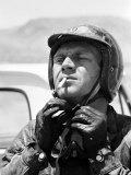 Actor Steve McQueen Putting on Helmet During 500 Mi Motorbike Race Across Mojave Desert