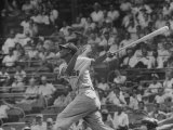 Action Shot of Chicago Cub's Ernie Banks  Following Direction of Baseball Resulting from His Hit