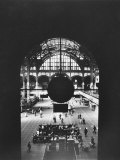 Interior of Penn Station Through Archway and Behind Suspended Clock  with Ceiling Ironwork