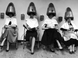 Women Sitting and Reading under Hairdryers at Rockefeller Center &quot;Pamper Club&quot;