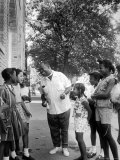 Musician Louis Armstrong with Neighborhood Kids