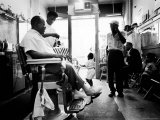 Musician Louis Armstrong in His Neighborhood Barber Shop