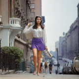 "Long Hair Woman with short skirt  lace top and sandals walking up street in ""New York Look"" fashion"