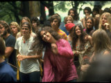 Psylvia Dressed in Pink Indian Shirt  Dancing in Midst of Crowd During Woodstock Music/Art Festival