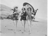 Frolicsome Trio of American Bathing Beauties Wearing the Latest Swimsuit Costumes