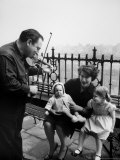 Violinist Isaac Stern and Entertaining Woman and Children