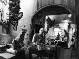 Reflected Portrait of Artist Claes Oldenburg  Sitting in Dirty  Studio Apartment