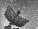 Radio Telescope Listening to Sound from Space as Visible Stars Circle Sky Forming Streaks of Light