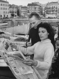 Actress Yvonne Mitchell and Husband Derek Monsey  Reading London Paper During Visit to Cannes